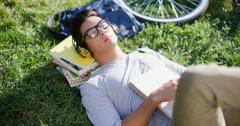 College student laying on the grass