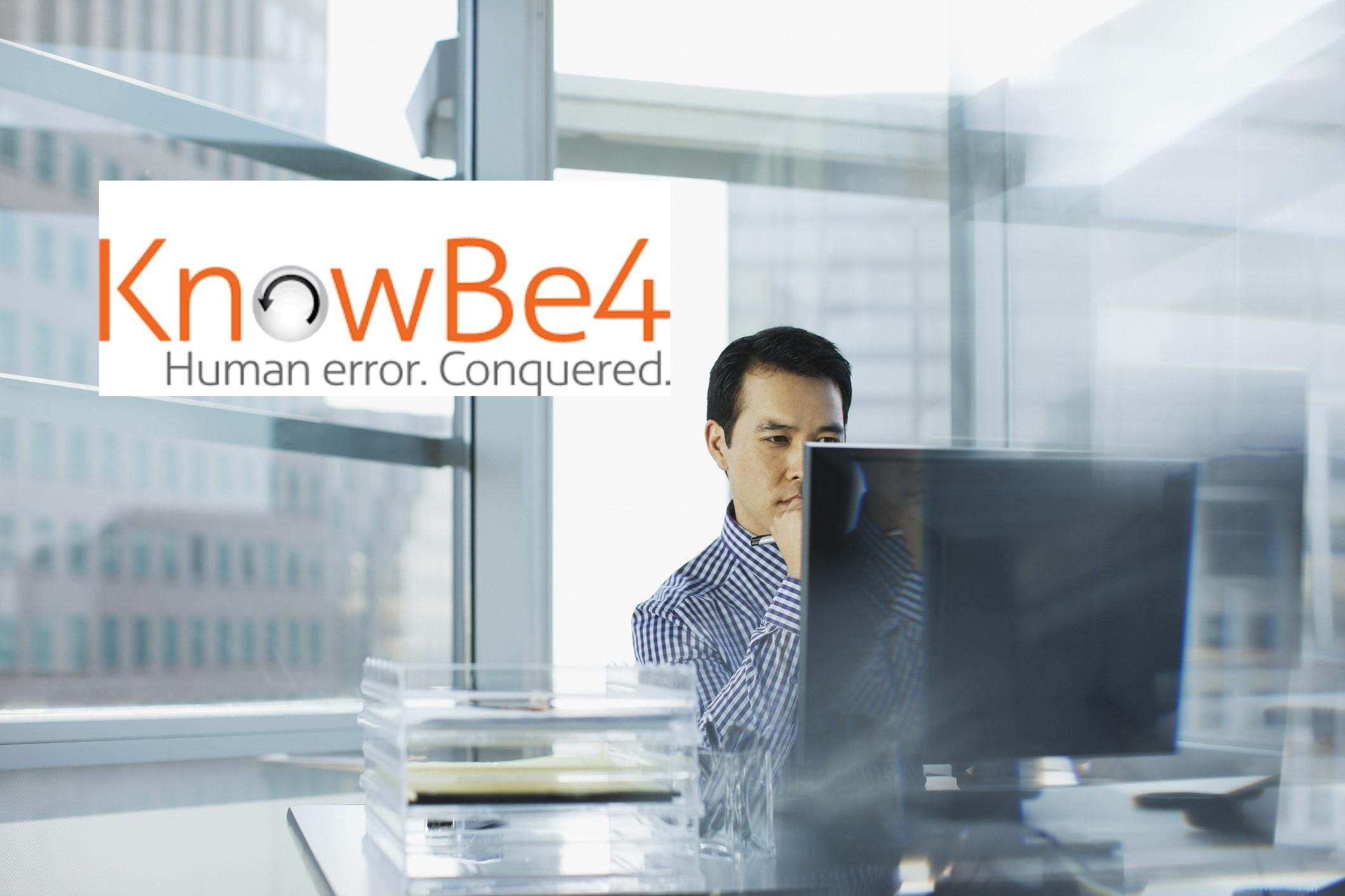 KnowBe4 logo over man on computer