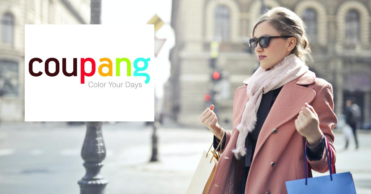 Woman in pink coat with shopping bags