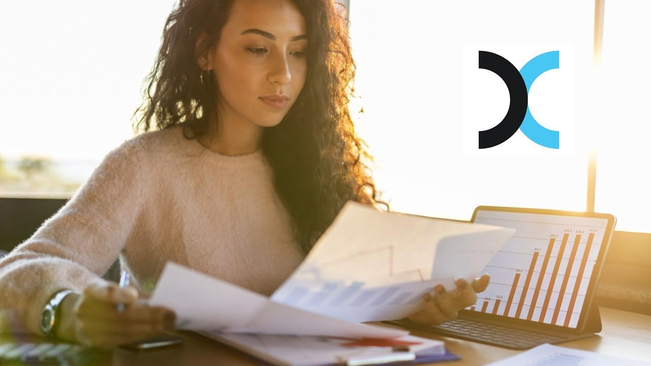 Woman looking at documents and Exela logo