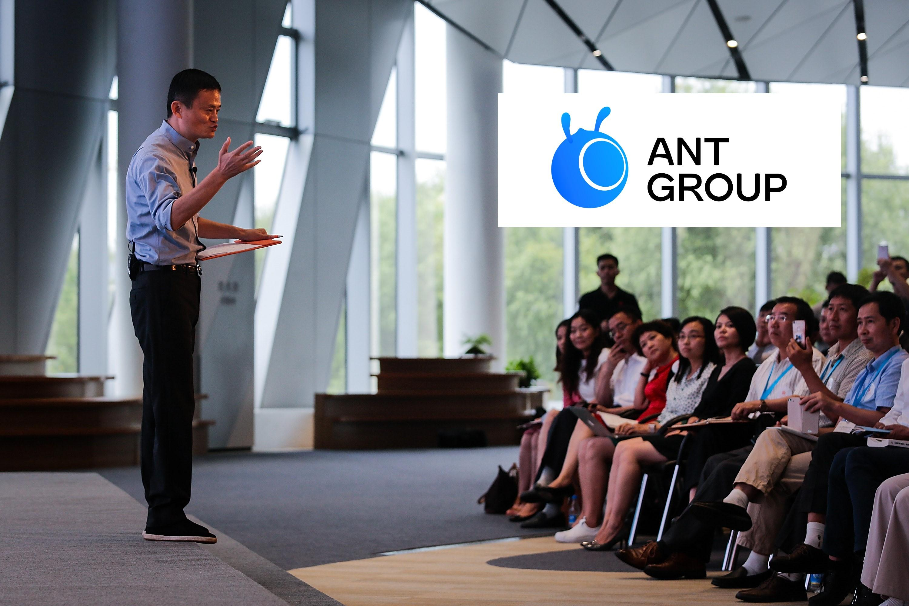 Jack Ma speaking to crowd with Ant Group logo
