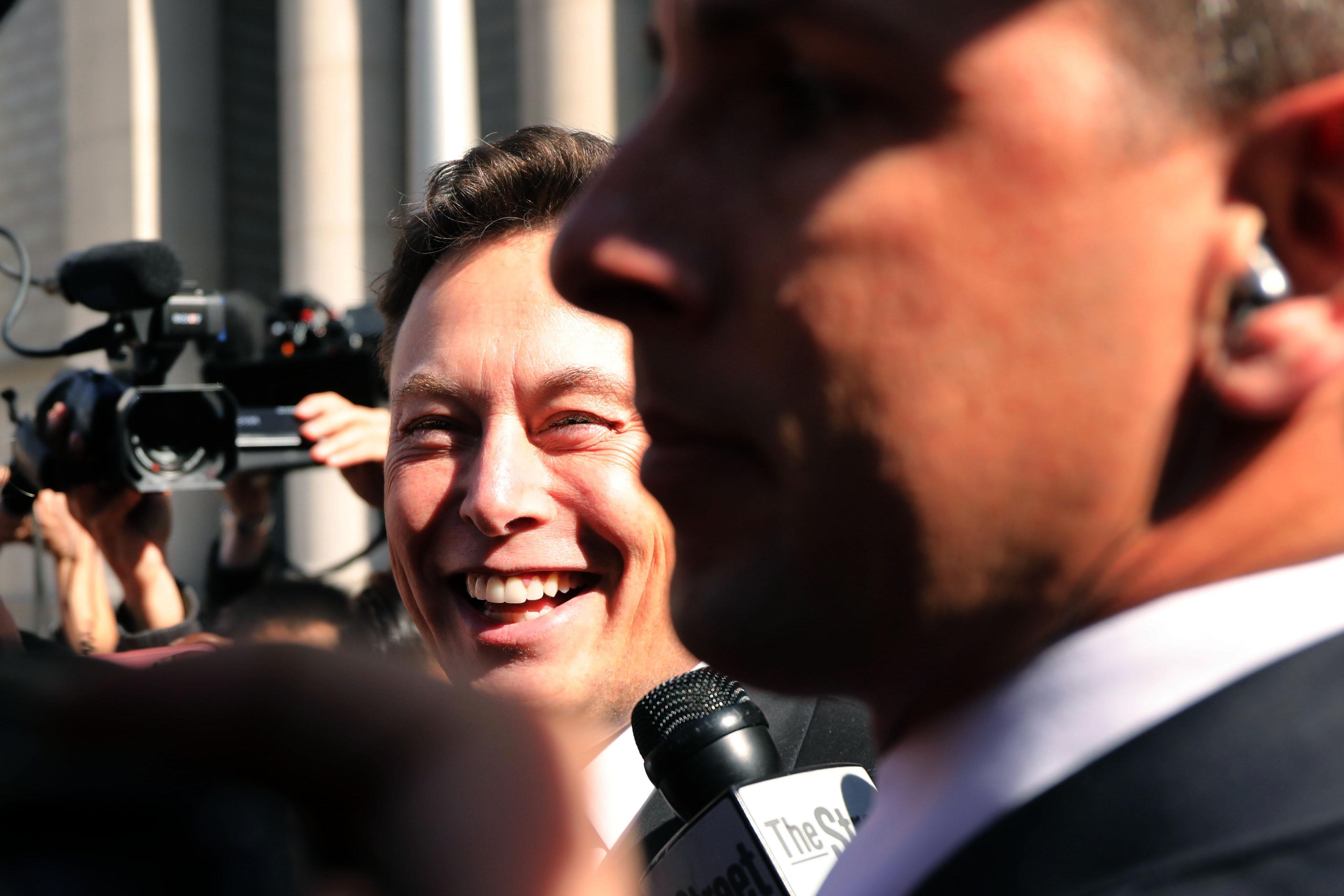 Elon Musk outside of court