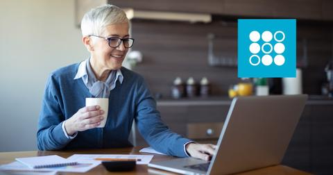 Woman looking on a laptop and SoFi logo