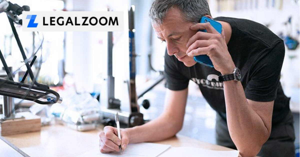 Man taking notes and the LegalZoom logo