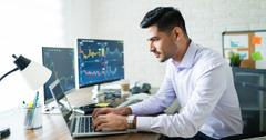 Investor looking on a computer