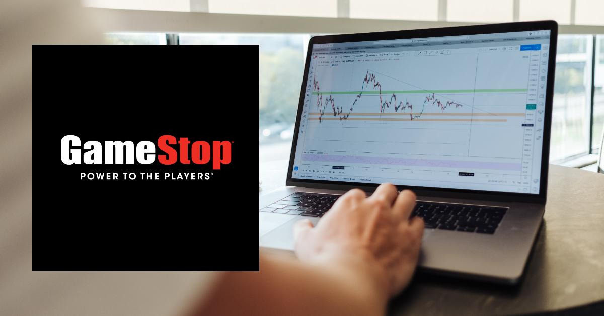 A stock price graph displayed on a laptop