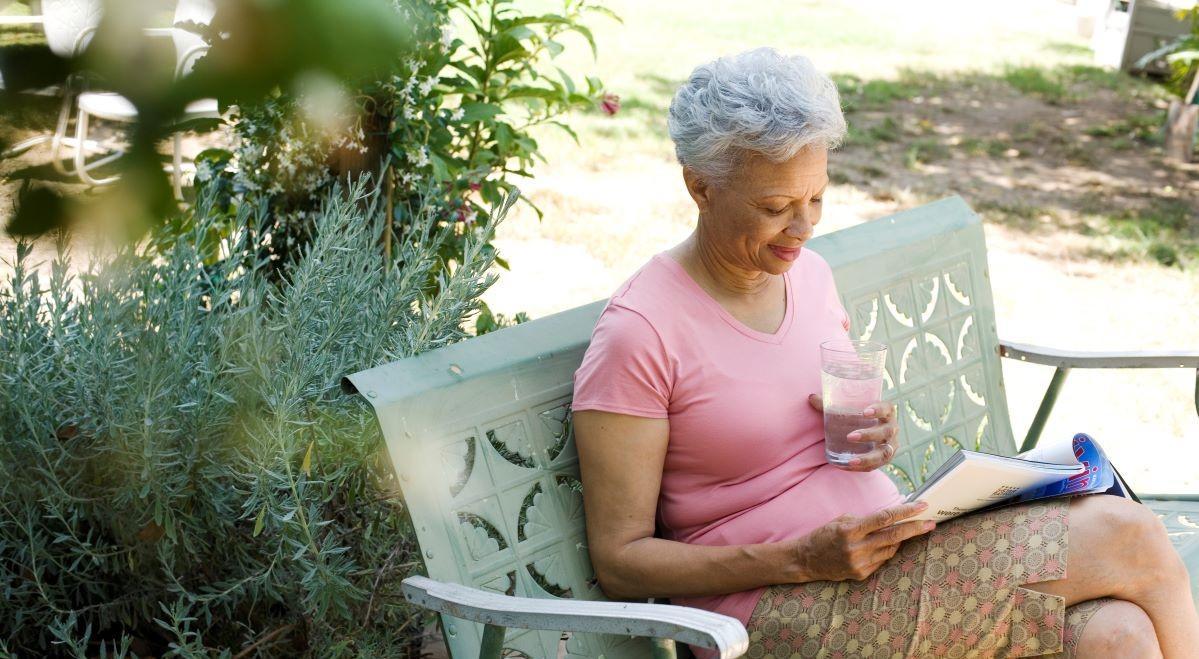 elderly person reading outside