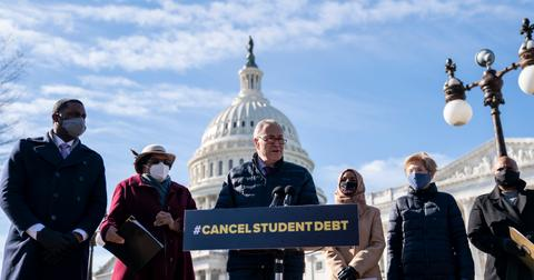 Senator Schumer and other members of congress speak in favor of student loan forgiveness outside the U.S. Capitol