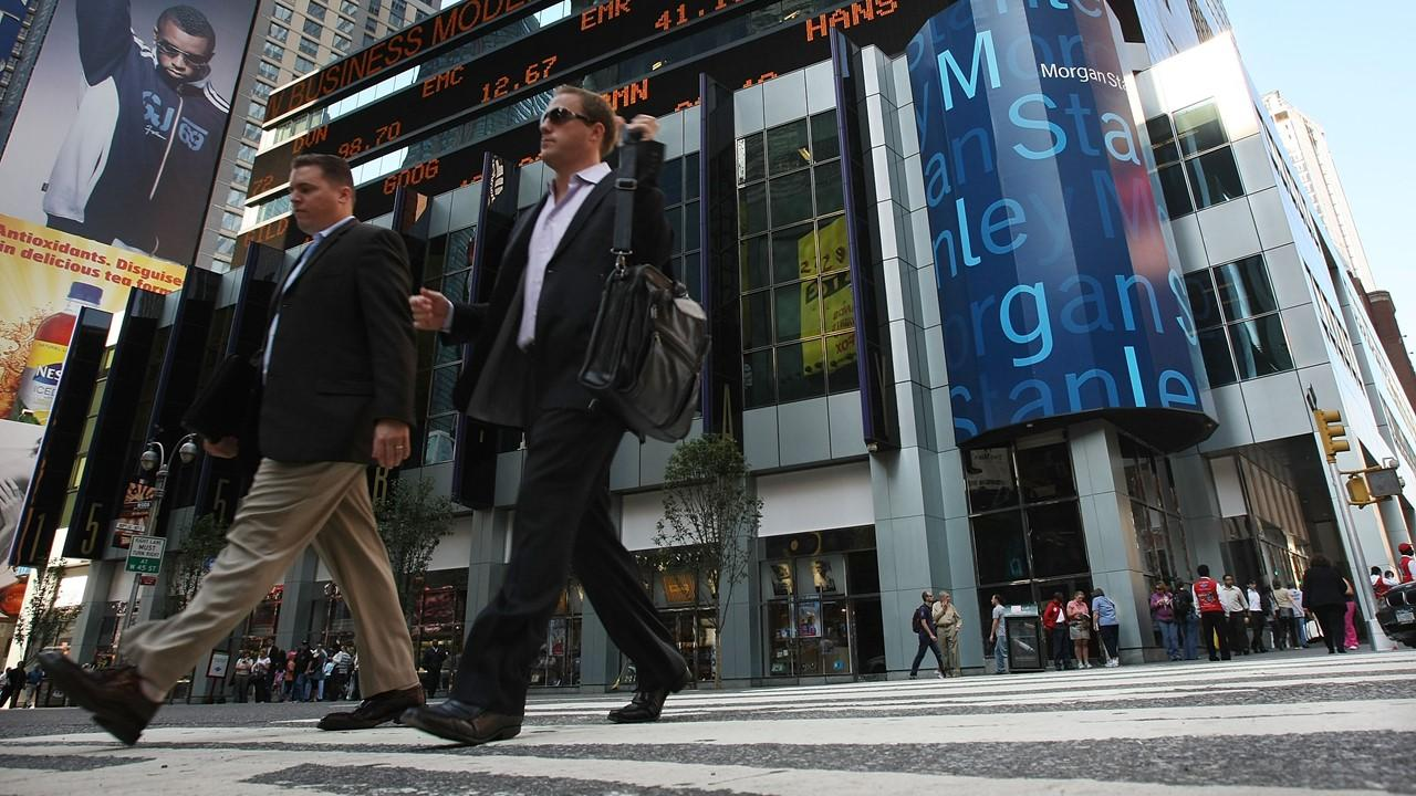 Men walking by Morgan Stanley headquarters