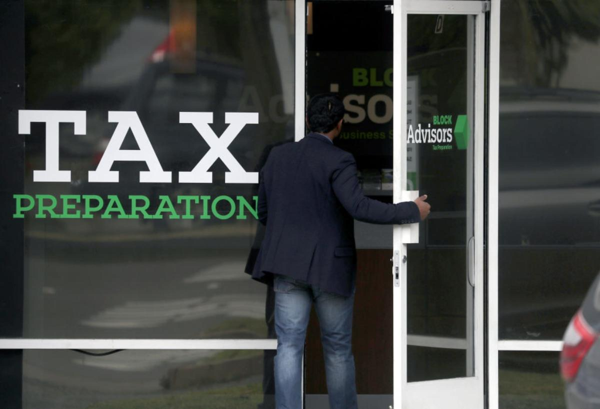 Man going into a tax preparation office