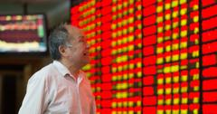 Investor looking at stock exchange