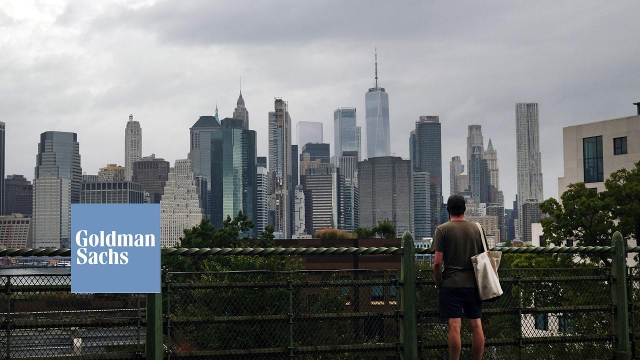 New York City skyline and Goldman Sachs logo