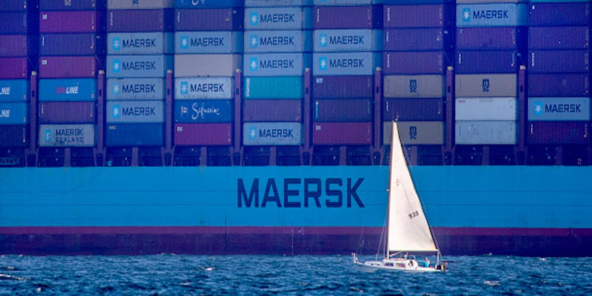 a cargo ship waits in the water to dock at the Port of Long Beach.