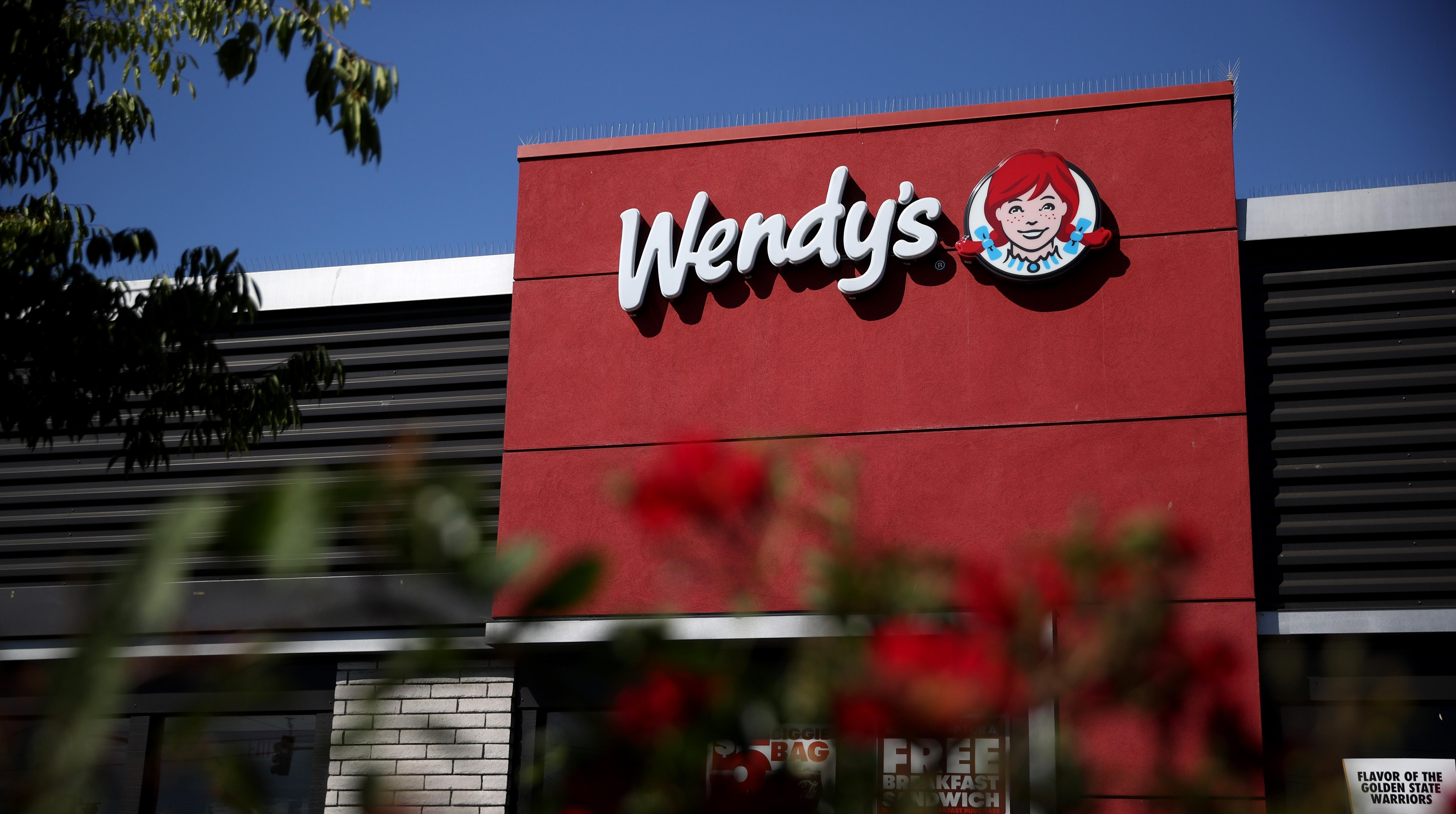 Wendy's storefront behind bushes