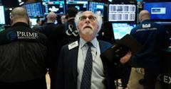 Stock trader looking at tech stock news