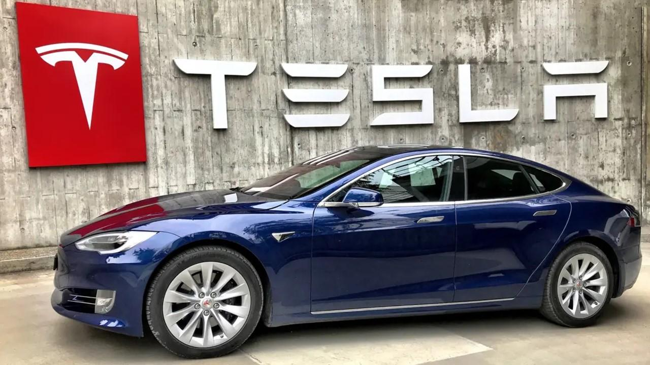 Tesla car and sign