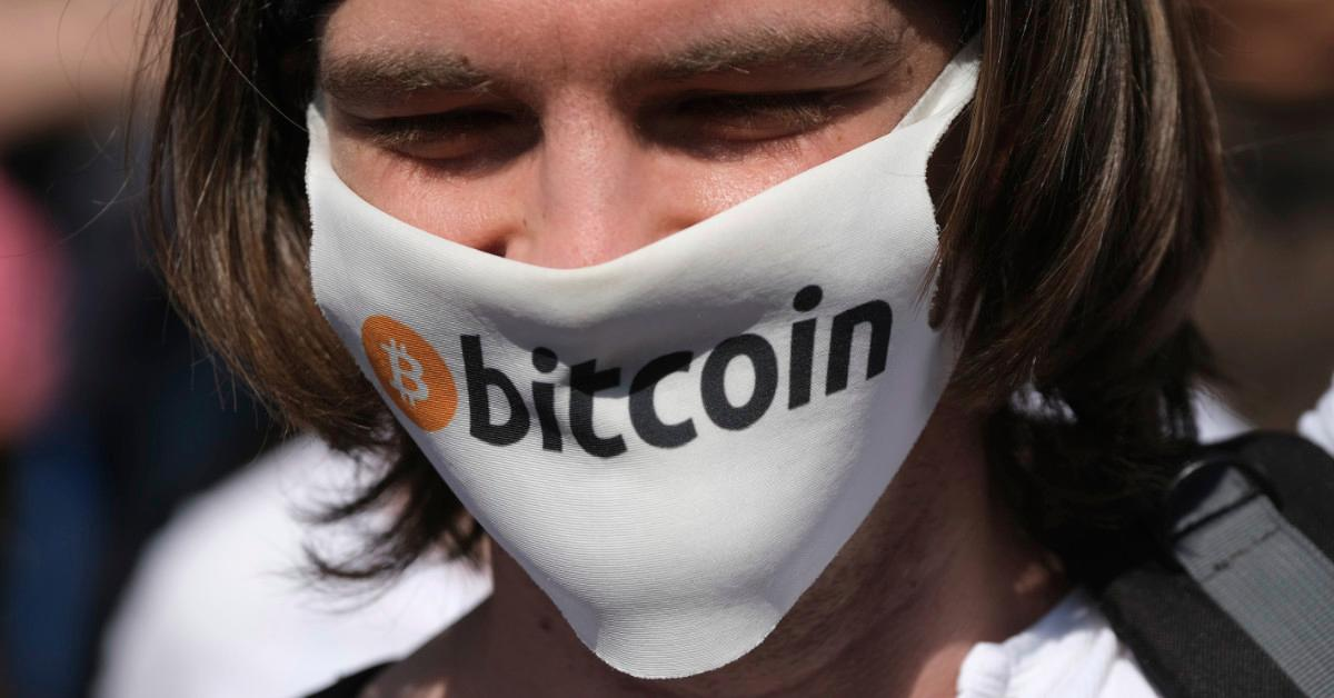 Person with Bitcoin facemask