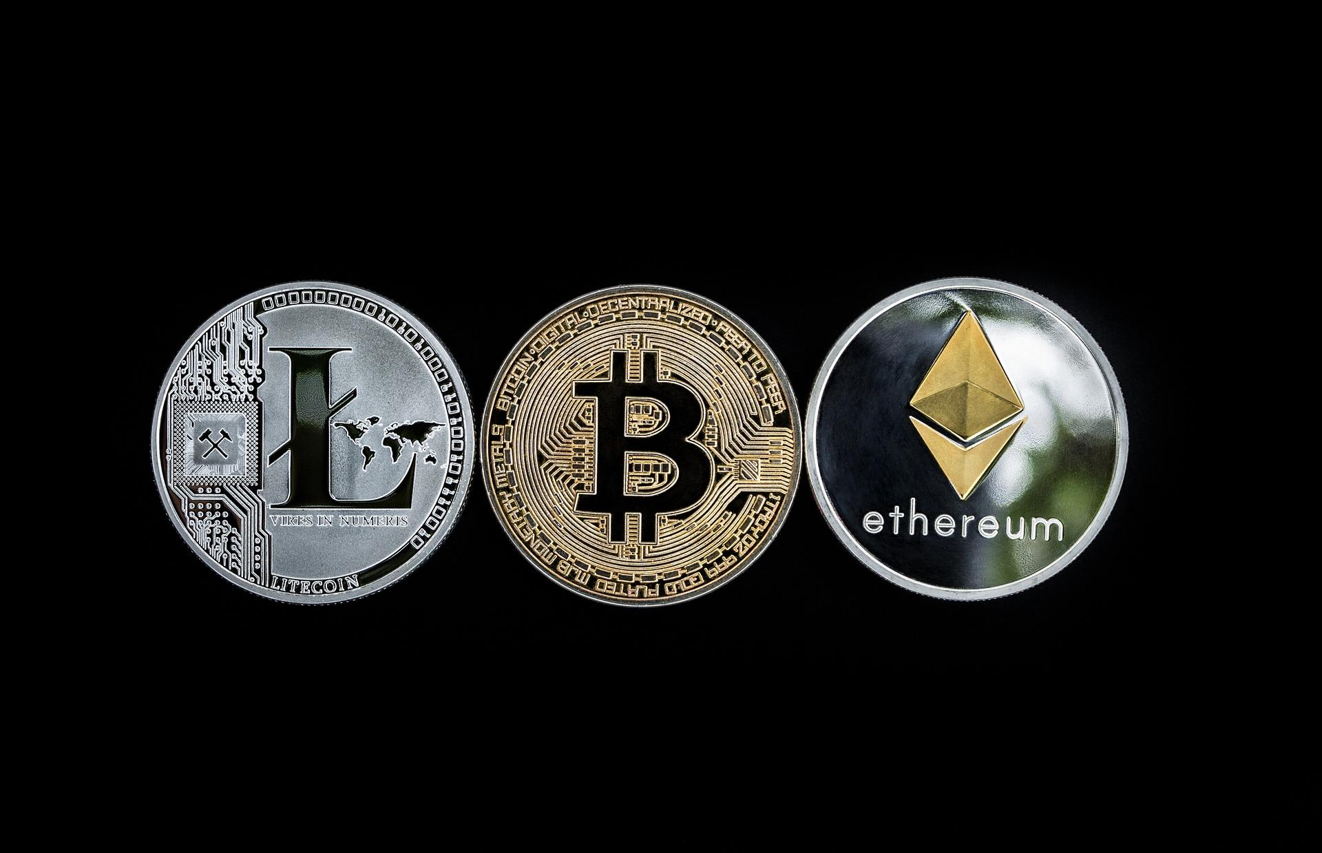 Bitcoin, Litecoin, and Ethereum coins