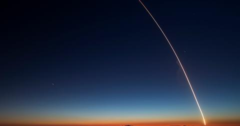 Rocket launches into the sky leaving trail