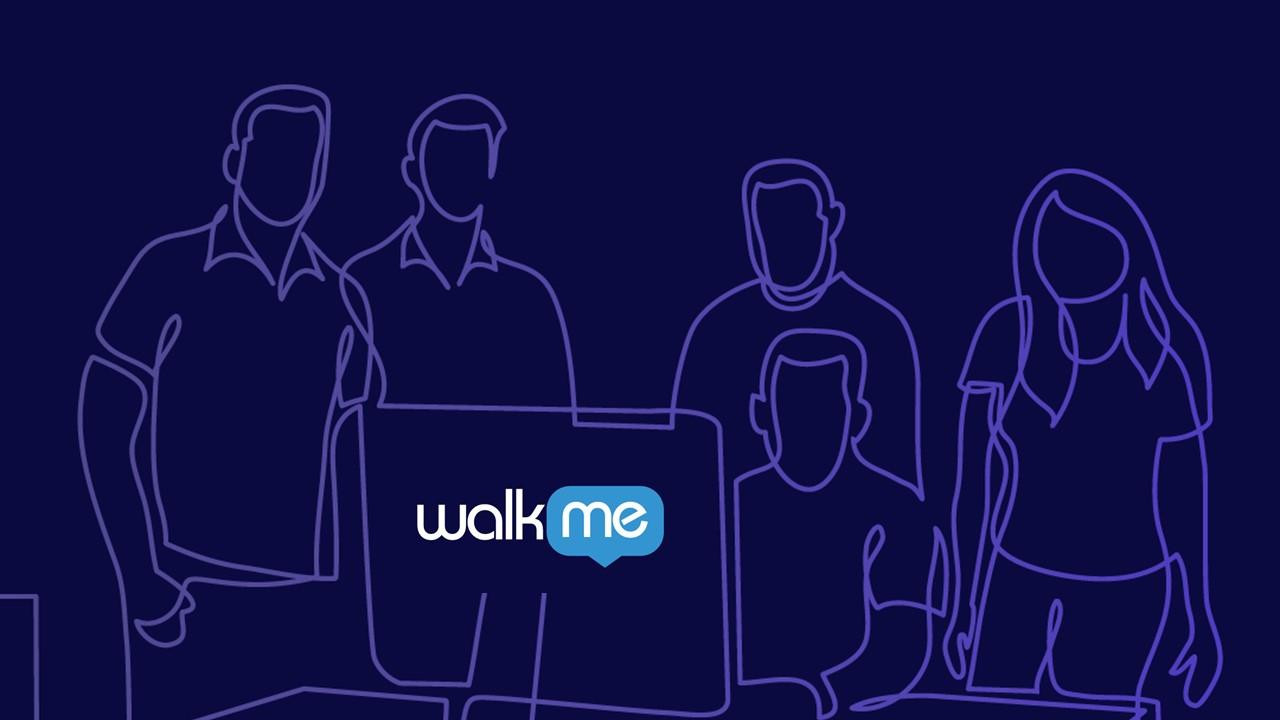 People standing around a computer and WalkMe logo