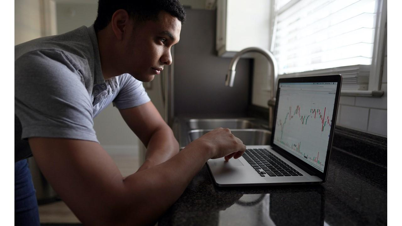 Man looking at a chart on a laptop