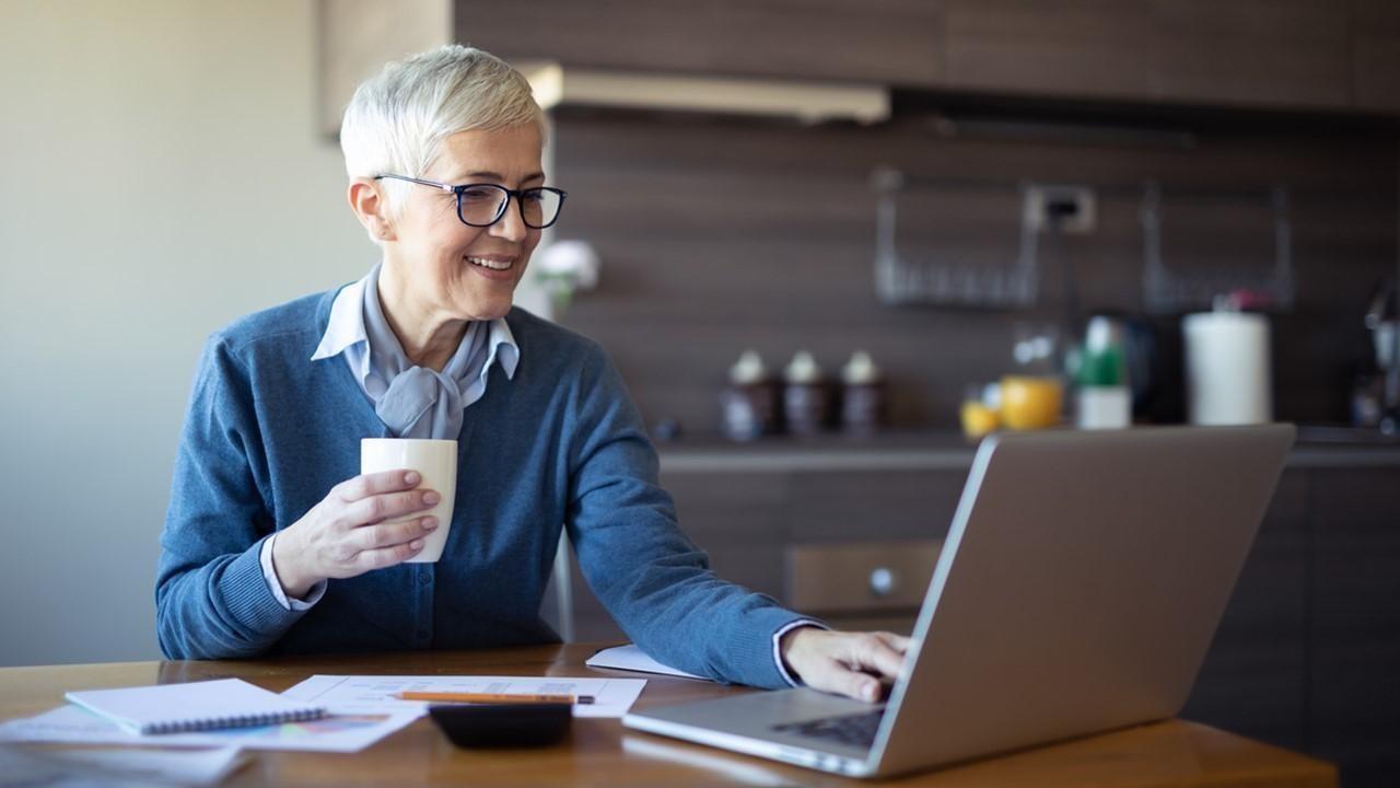 Woman looking at spousal benefits on a laptop