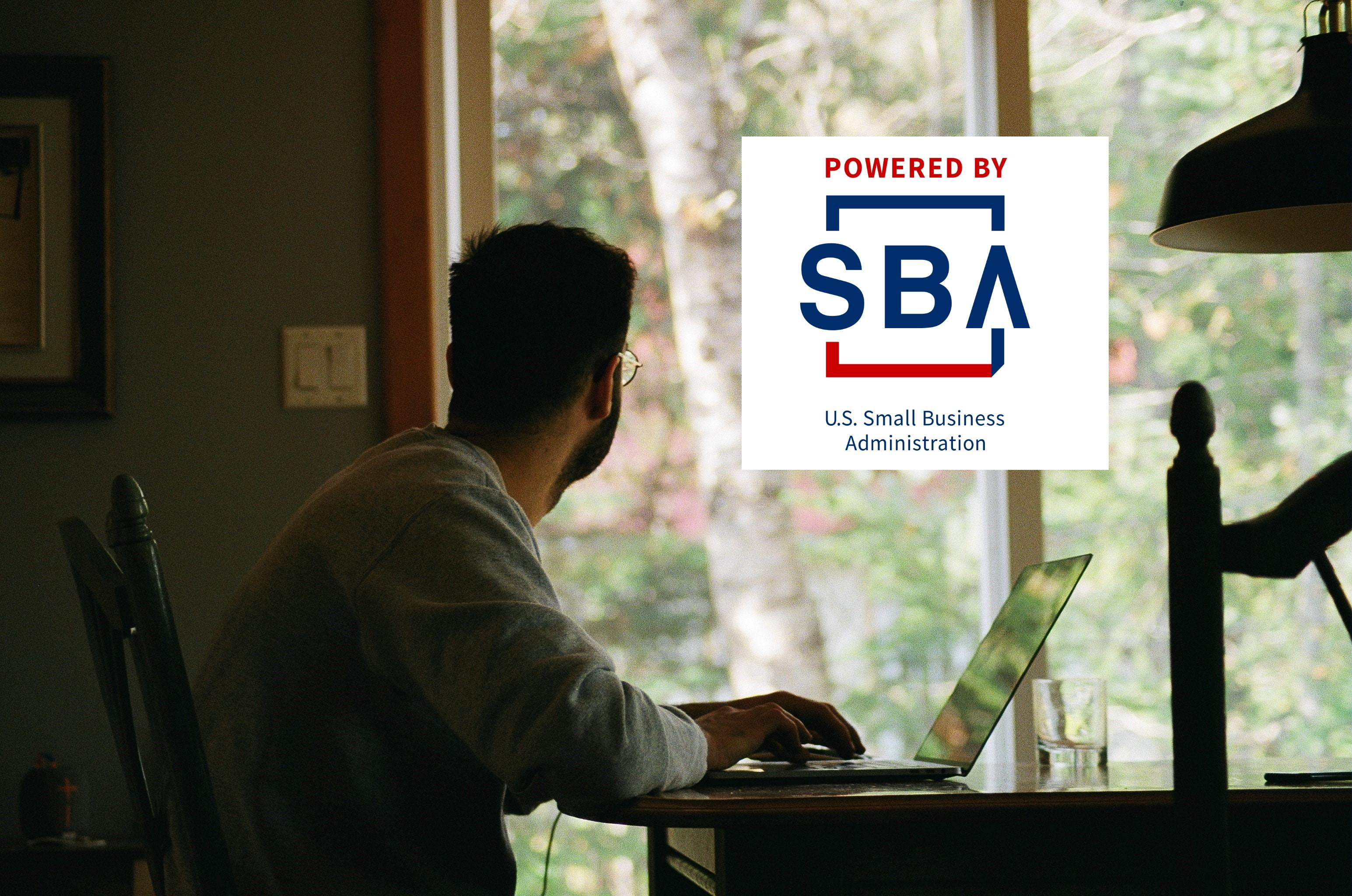 SBA logo over independent contractor working from home