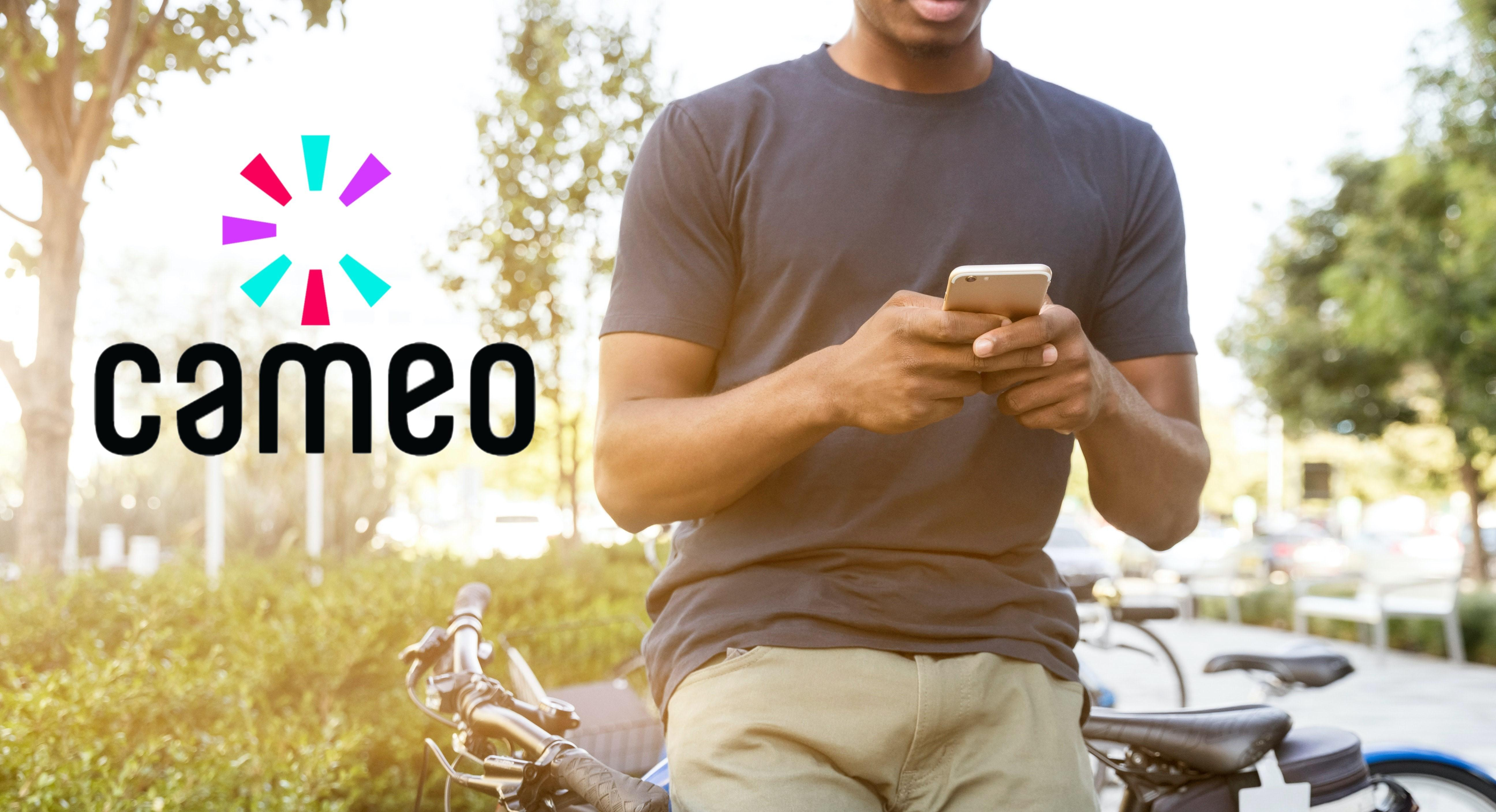 Cameo logo over guy using phone