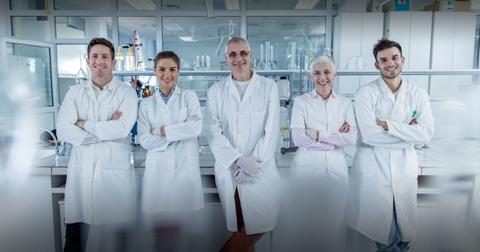 Scientists standing in a lab
