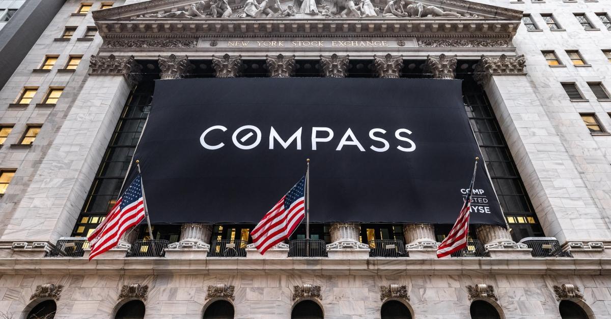 Compass banner on Wall Street