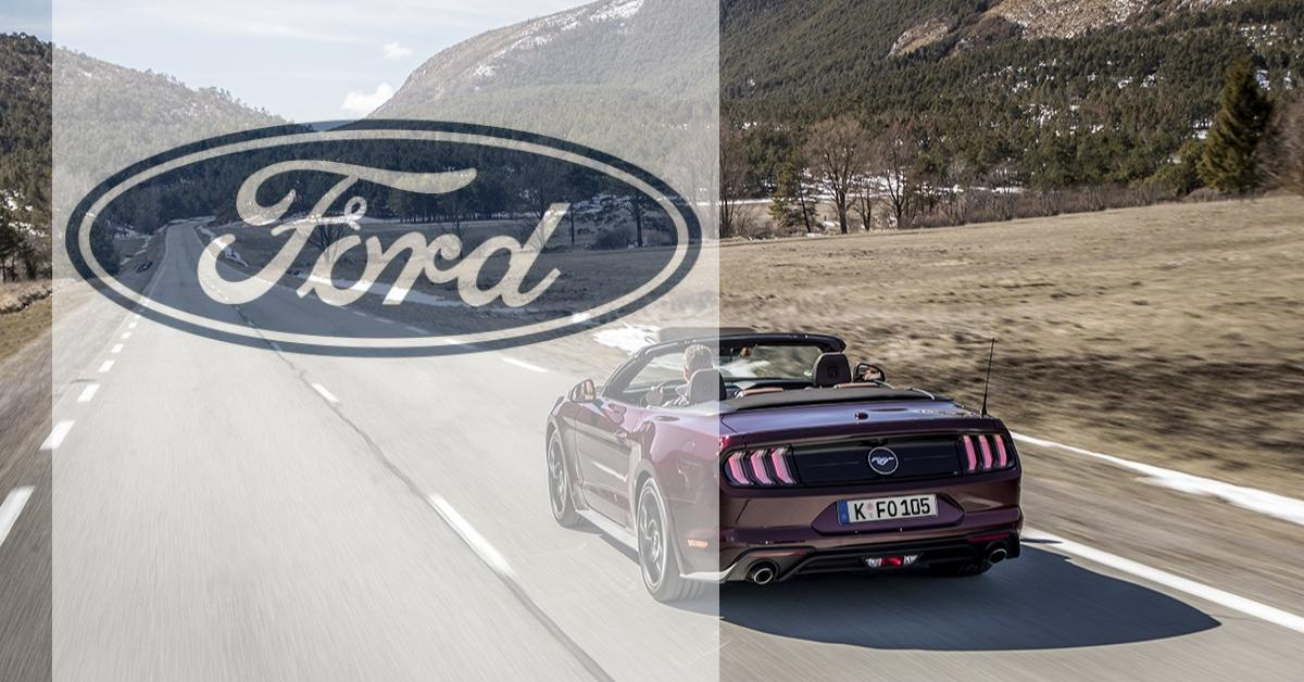 A Ford convertible on a highway
