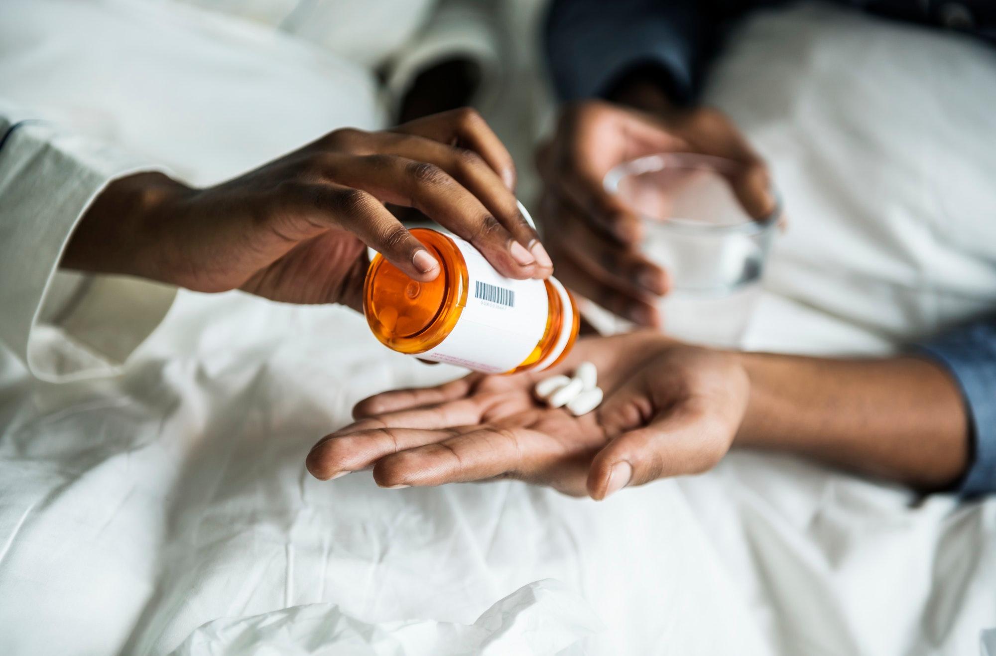 uploads///a woman handing pills to her boyfriend
