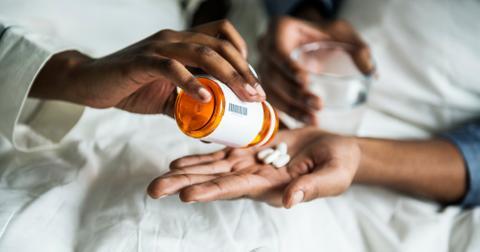 uploads/2019/12/a-woman-handing-pills-to-her-boyfriend.jpg