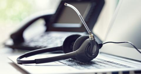 uploads/2019/12/headset-headphones-telephone-and-laptop-in-call-center.jpg