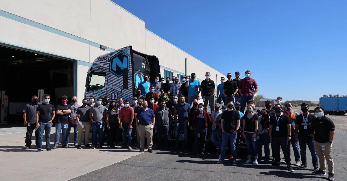 Nikola employees posing with a truck