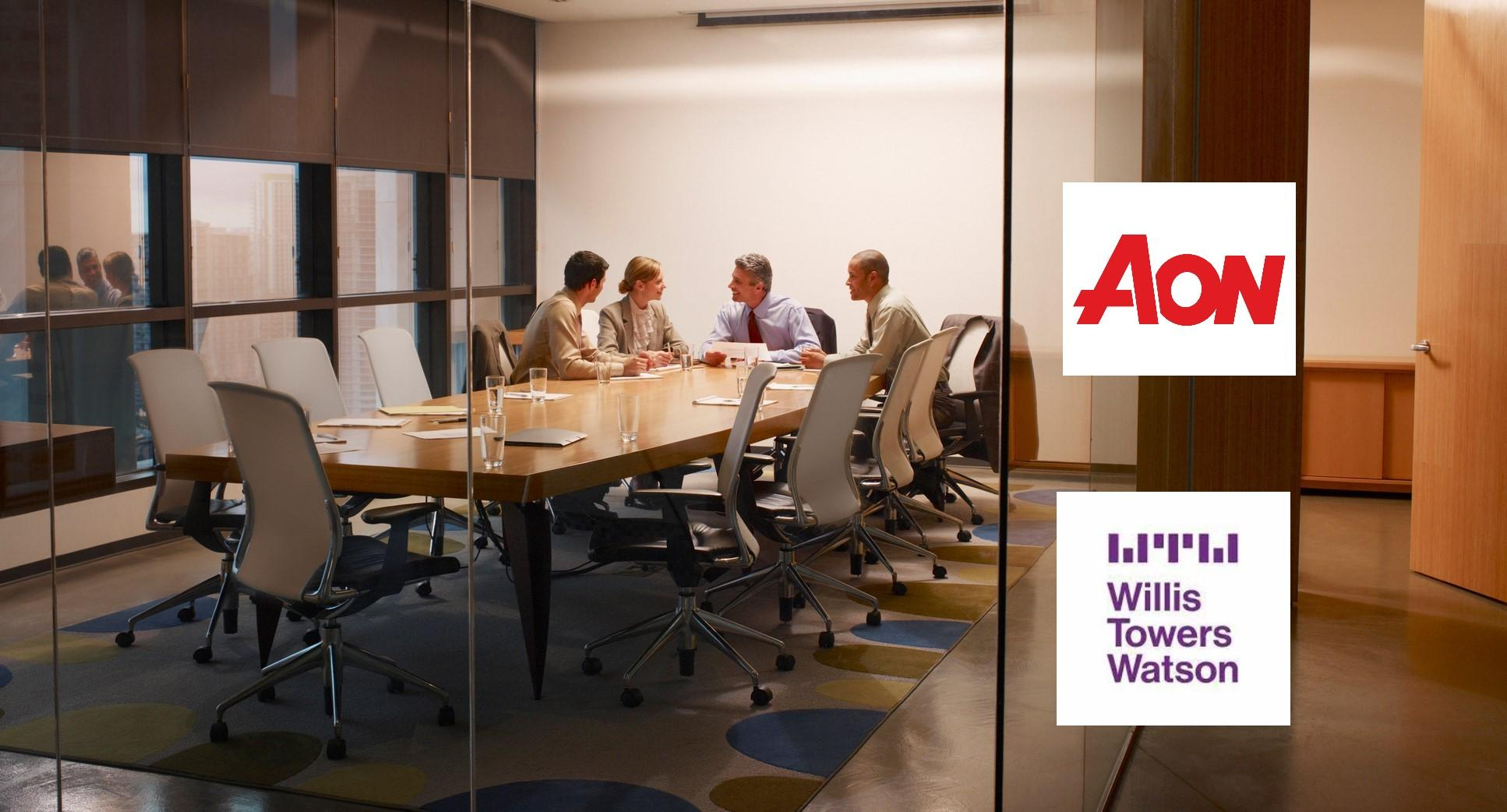 Aon Willis Towers Watson logos over deal meeting