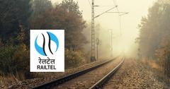 Railroad tracks and RailTel logo