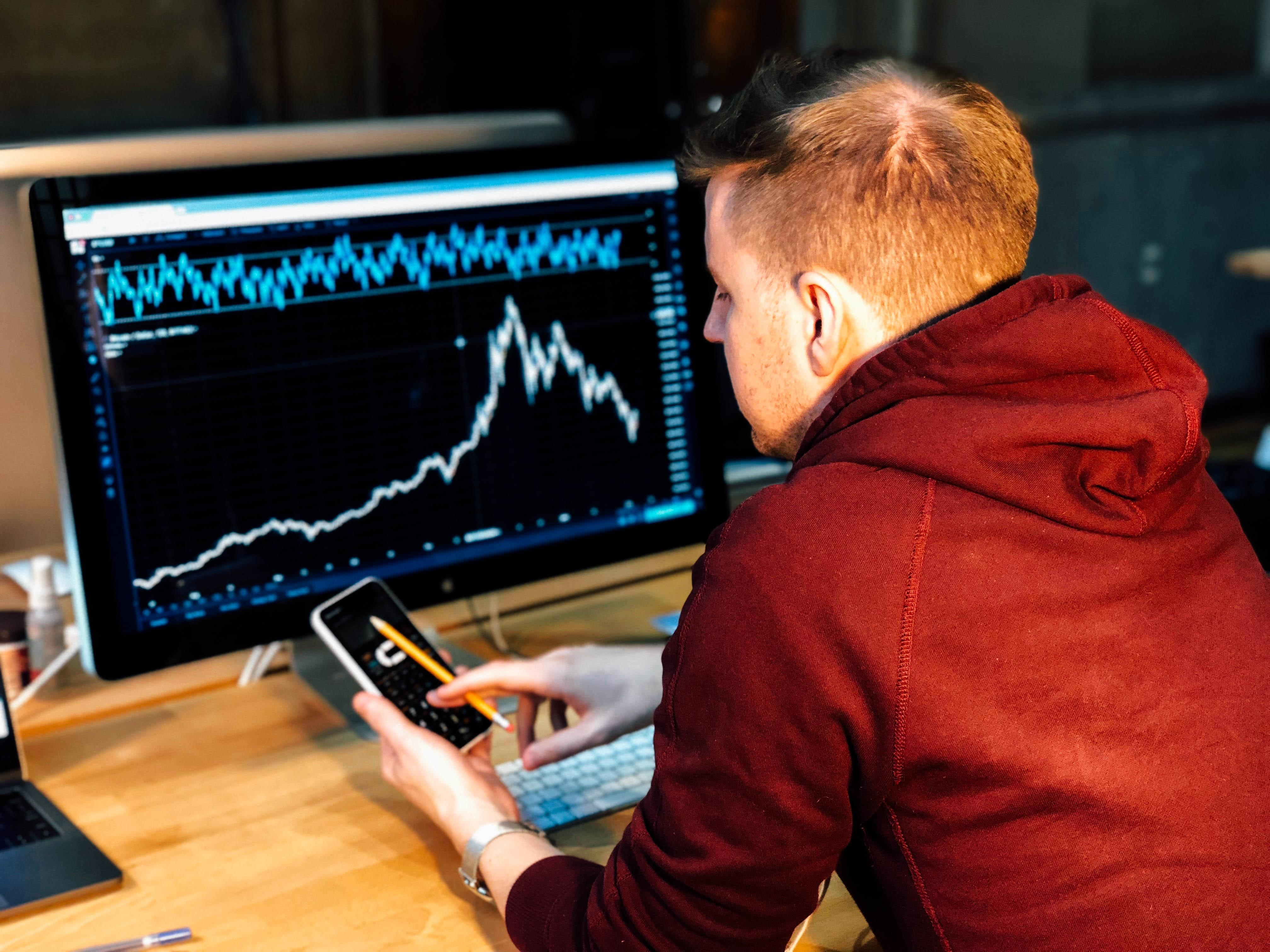 Man researching low float stocks on computer