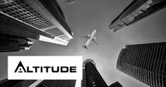 Jet flying over skyscrapers with Altitude logo