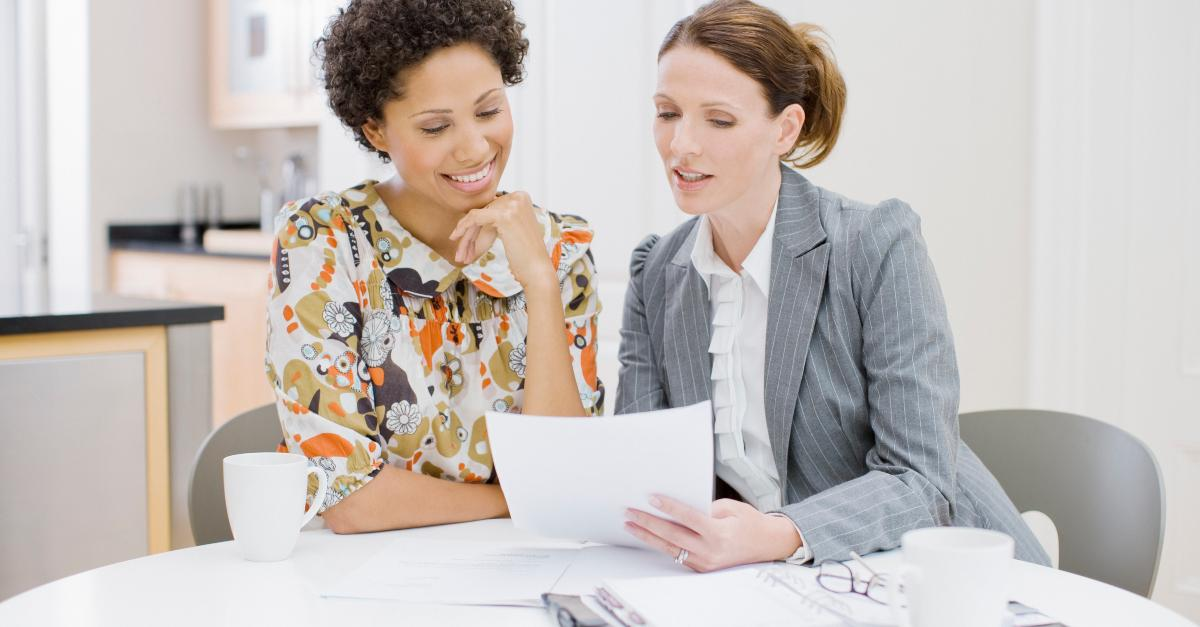 Two businesswomen reviewing papers