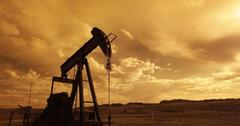 uploads///oil pump jack sunset clouds