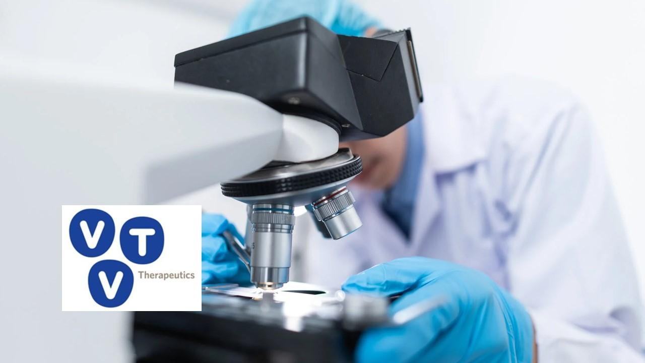 Scientist using a microscope and vTv Therapeutics logo
