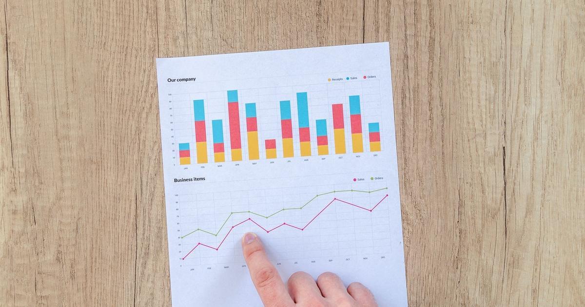 Person analyzing buyback data