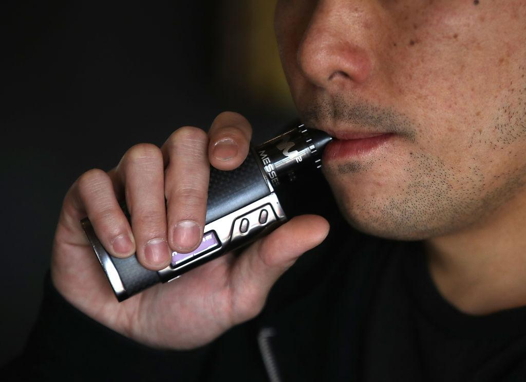 Man using a vaporizer