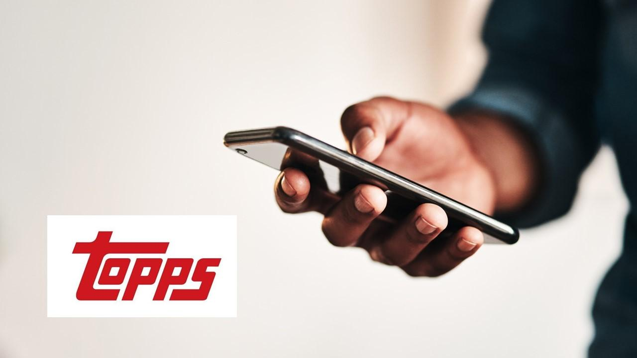 Man using a smartphone and Topps logo