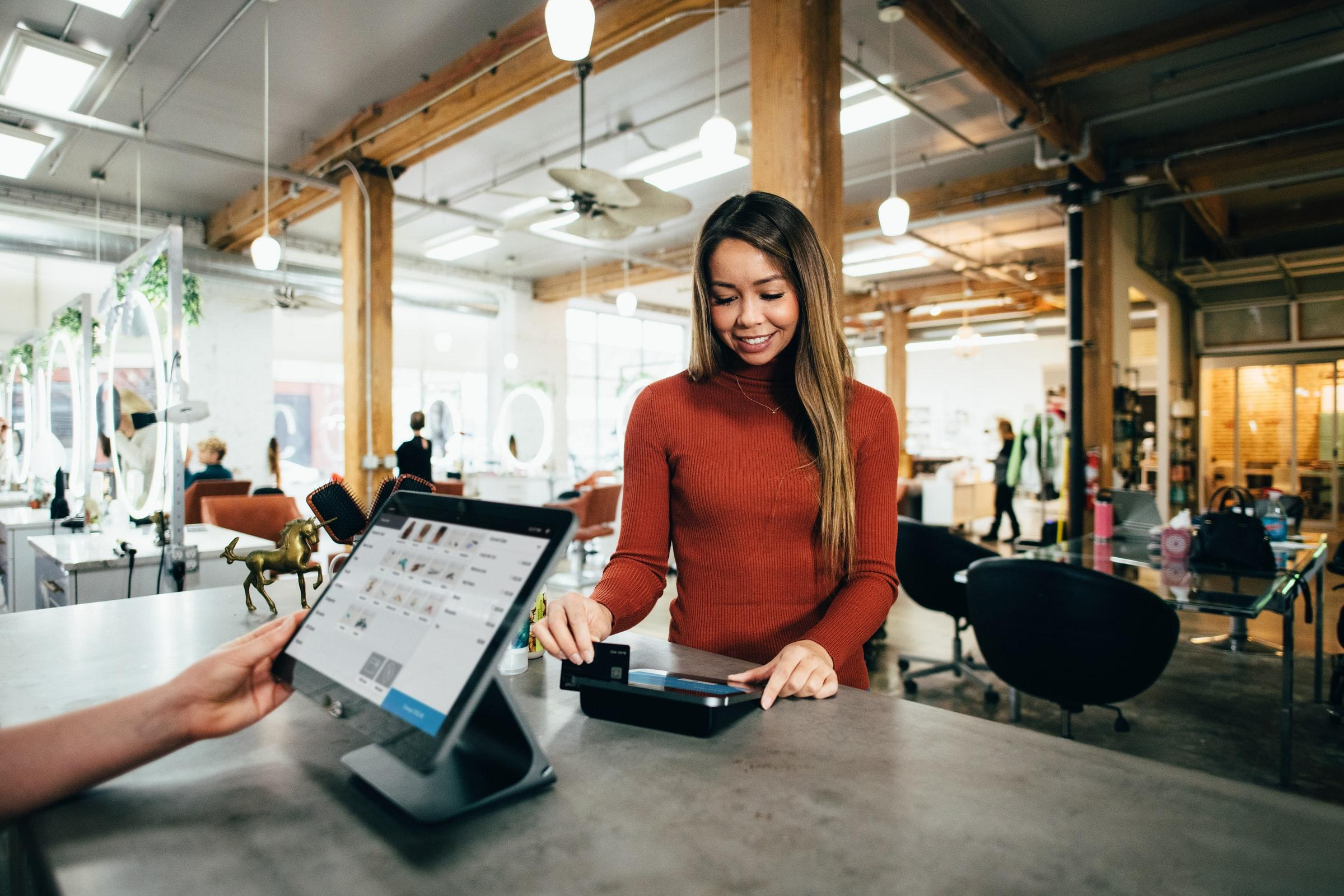 Woman using a payment machine