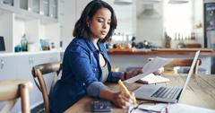 Woman working at computer on stock investments