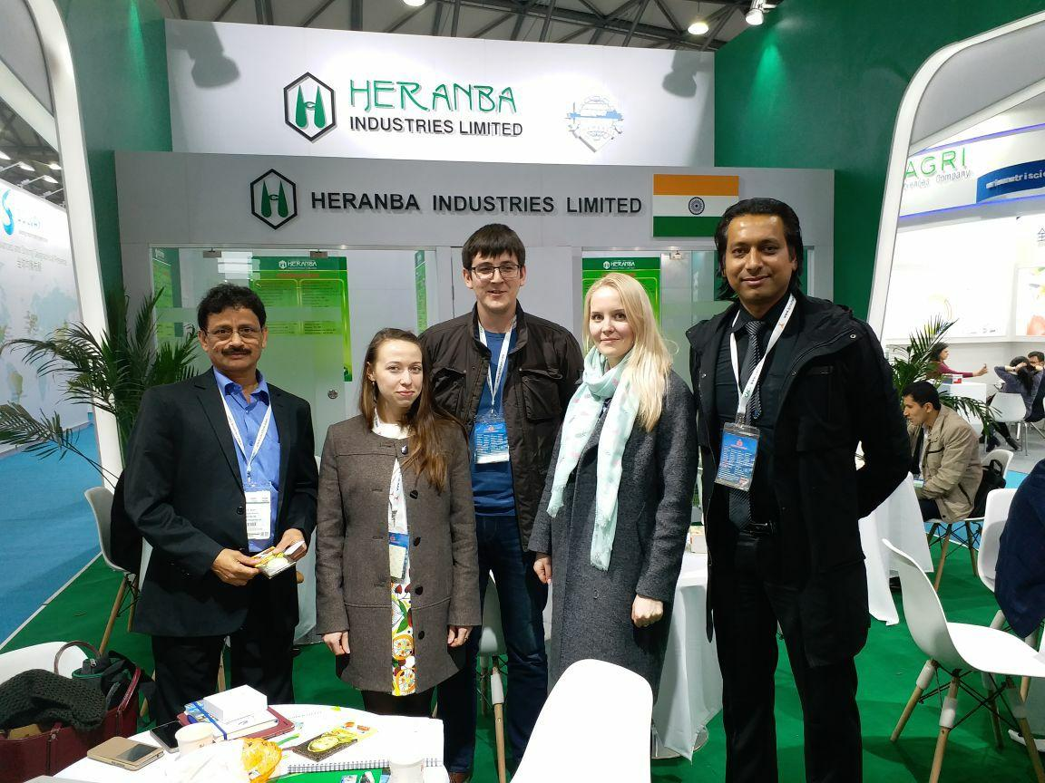 People standing at Heranba Industries' event day