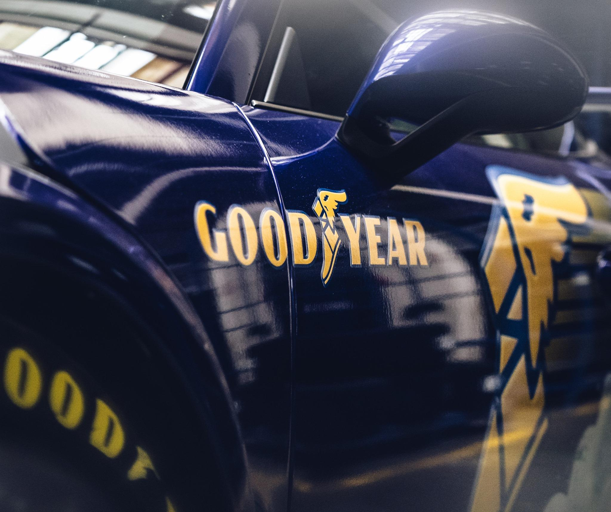 Car with a Goodyear logo and tires