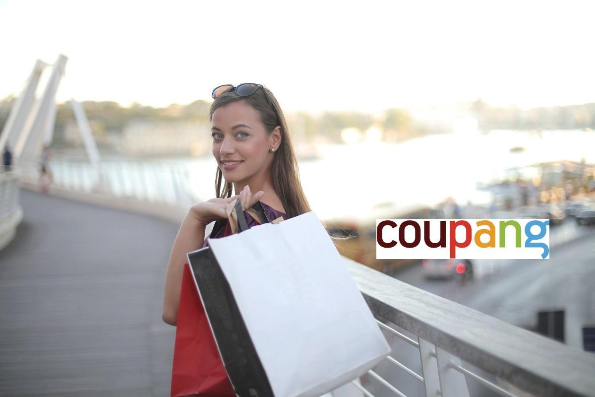 Woman carrying a shopping bag and Coupang logo